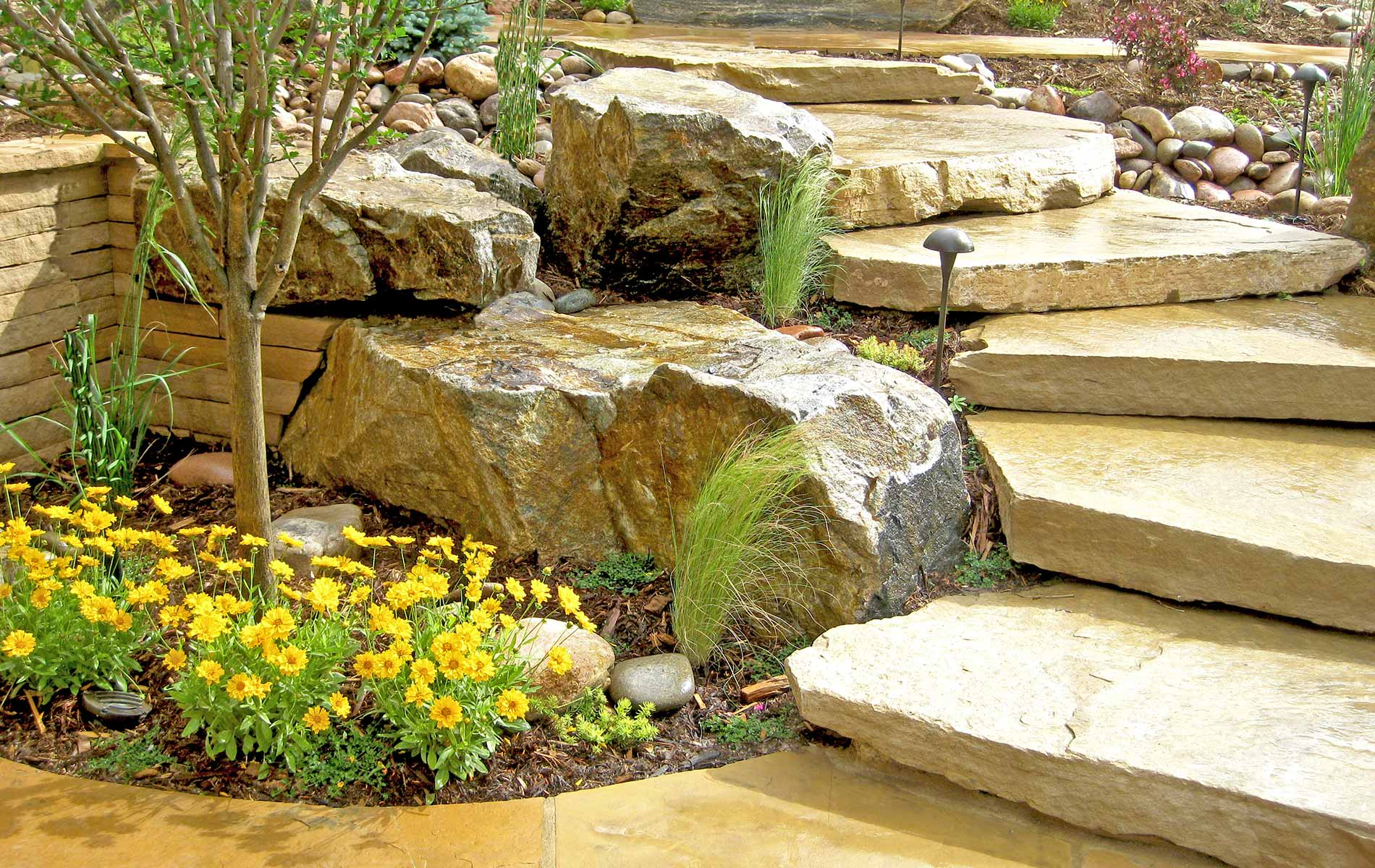 Natural stone stairs and plantings in Rustic Outdoor Living in Arvada Mile High Landscaping in Denver