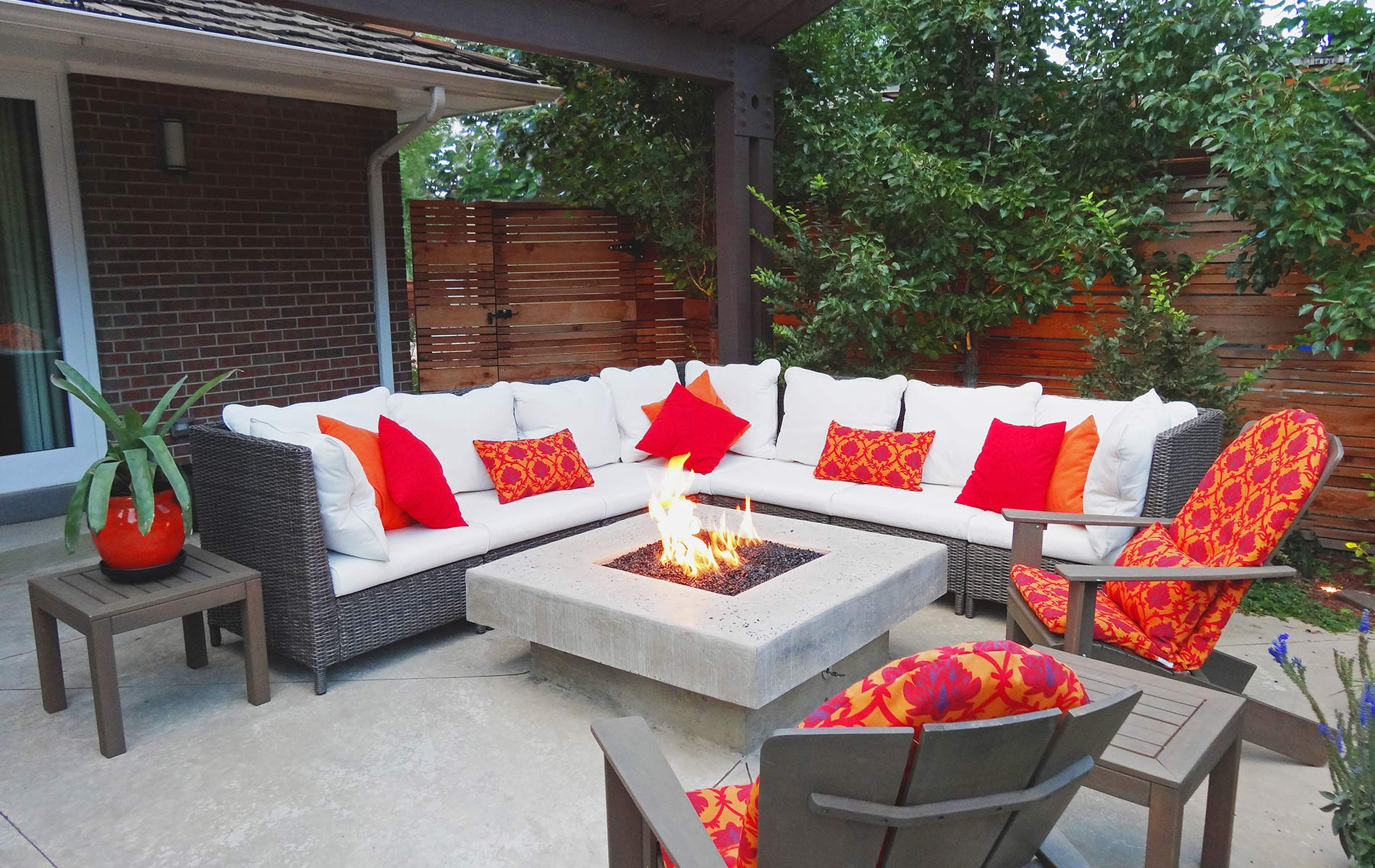 Sparkling glass topped firepit and sitting area in Award Winning Outdoor Room Mile High Landscaping in Denver