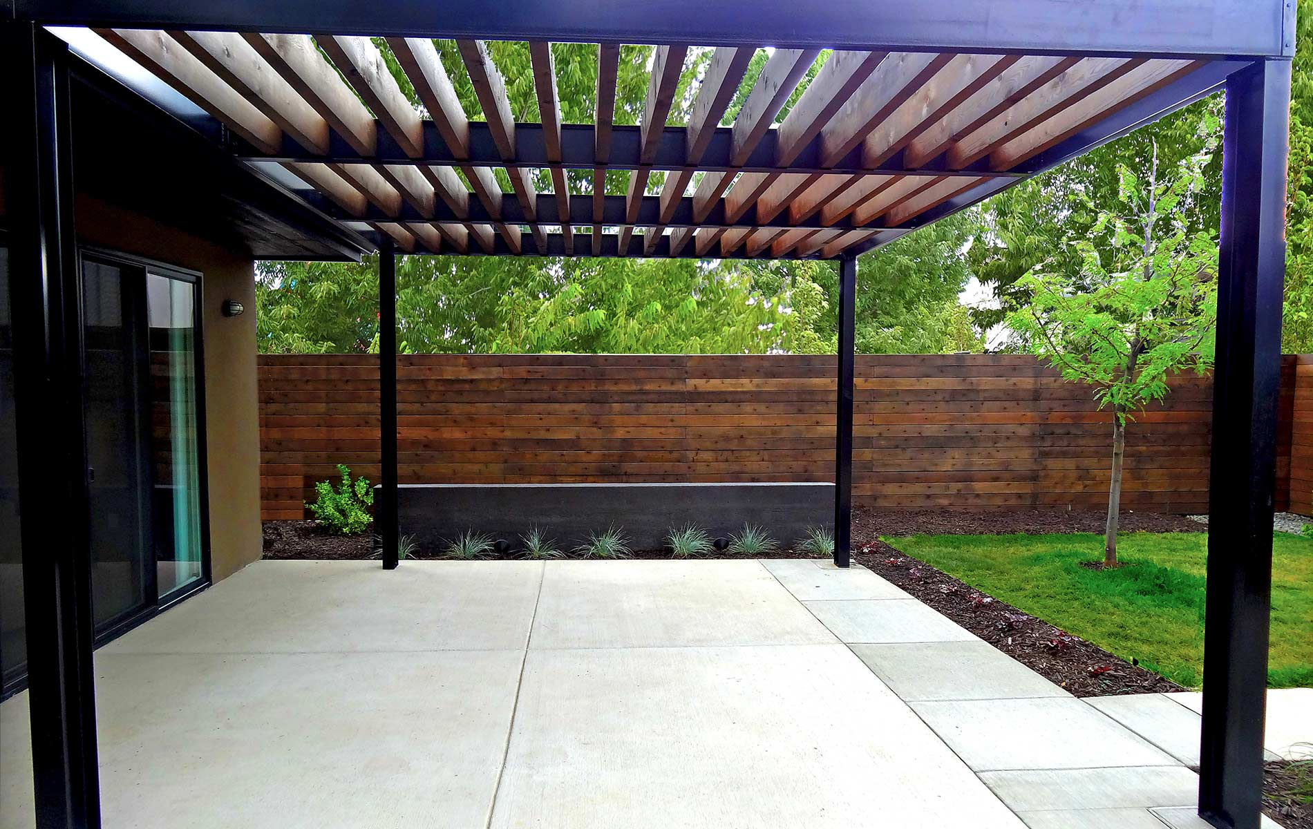 Custom Modern Metal Arbor On Contemporary Concrete Patio